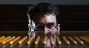 Businessman Staring at Row of Pencils --- Image by © Hans Neleman/Corbis
